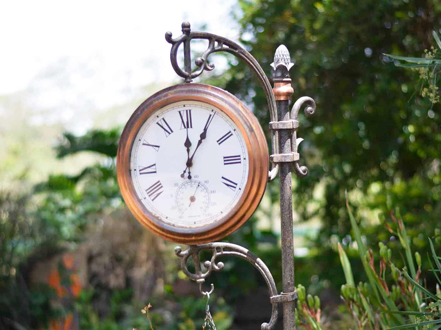 Garden clock with thermometer